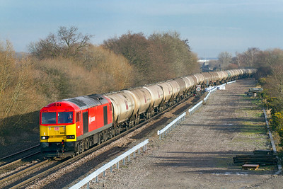 60091 heads through Stenson Junction with 6M57 Lindsey to Kingsbury loaded tanks. Friday 13th January 2012.