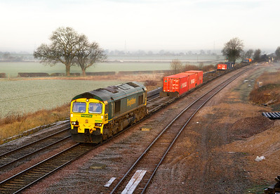 66504 heads a very lightly loaded 4O54 06.15 Leeds to Southampton through the frost and mist at Elford Loop. Friday 13th January 2012.