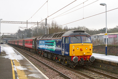 47853 'Rail Express' heads the returning DRS crerw trainer 5Z46 13.27 Stoke-on-Trent Sideway Loop to Crewe via Manchester Victoria and Warrington BQ through Longport with 47501 'Craftsman' on the rear. Wednesday 16th January 2013. Stock consists of Ex Virgin Mk2's 6158,1212, 3304, 3345, 3386 & 9507.