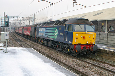 47501 'Craftsman' storms through Longport at line speed with 5Z45 09.00 Crewe to Stoke-on-Trent Sideway Loop via Liverpool Lime Street, Manchester Victoria and Stockport DRS crew training service. 47853'Rail Express' is dead on the rear. Wednesday 16th January 2013.