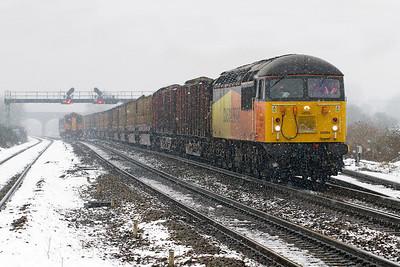 56094 heads through the snow at Pilning with 6Z52 07.13 Chirk Kronospan to Teigngrace empty log train. Wednesday 23rd January 2013.