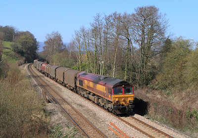 66121 drifts down past Ponthir with 6V75 09.30 Dee Marsh to Margam via Llanwern empty steel carriers. Tuesday 27th March 2012.