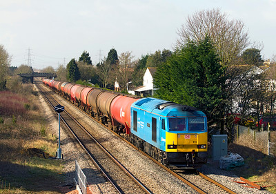 60074 'Teenage Spirit' passes the site of Portskewett station with 6B13 05.05 Robeston to Westerleigh loaded Murco tanks. Thursday 8th March 2012. Note the new standard NetWork Rail lightweight signal on the left.