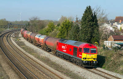 60007 'The Spirit of Tom Kendell' passes Undy with 6B13 05.05 Robeston to Westerleigh loaded Murco tanks. Thursday 29th March 2012.