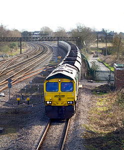 66598 passes Magor crossovers with 6M61 08.25 Portbury to Rugeley Power Station loaded coal. 8th March 2012.