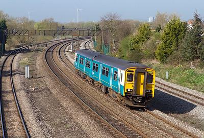 150241 on a Maesteg to Cheltenham Spa service passes Undy, Thursday 29th March 2012.