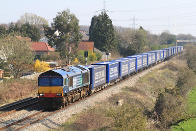 The 4V38 08.22 Daventry to Wentloog Tesco Less CO2 train with 66301 in charge passes Portskewett, Tuesday 27th March 2012.