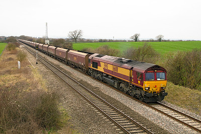 With 31 HTA's in tow 66011 passes Badgeworth with 4E66 08.55 Margam to Redcar empty coke hoppers. Friday 16th March 2012.