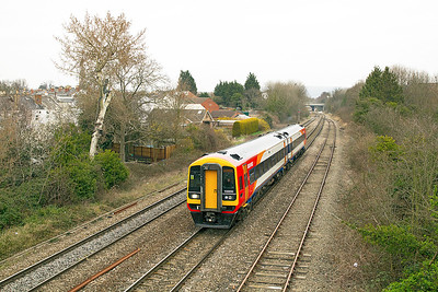 SWT 158890 on hire to FGW departs from Cheltenham Spa passing Hatherley Loop forming the 09.40 to Swindon. Friday 16th March 2012.