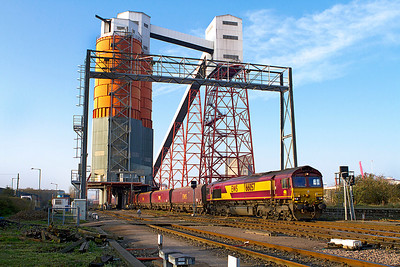 66057 pulls under the loading bins at Avonmouth loading coal for Didcot Power Station. Tuesday 27th March 2012.