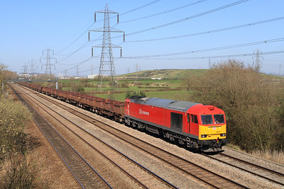 60079 passes Duffryn with 6B04 14.23 Llanwern to Margam empty steel trip working. Tuesday 27th March 2012.