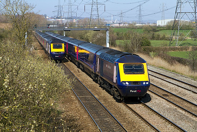 The 12.45 Paddington to Swansea with power cars 43122 & 43140 passes the 13.28 Swansea to Paddington at Duffryn. Tuesday 27th March 2012.
