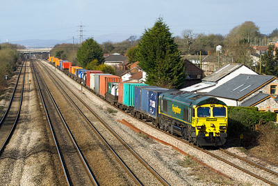 66501 'Japan 2001' brings the 4O51 09.58 Wentloog to Southampton Freightliner along the slow at Magor, Thursday 8th March 2012.