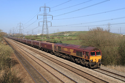 66155 passes Duffryn with the 14.48 East Usk Yard to Onllwyn empty HTA's, Tuesday 27th March 2012.