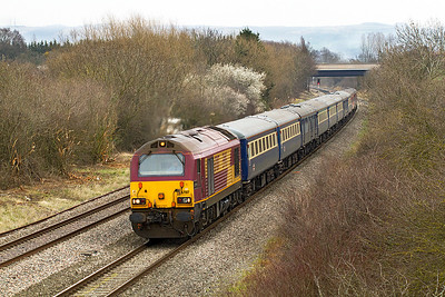 Cardiff - Paignton locohauled stalwarts 67017 'Arrow' & 67016 top & tail 5Z18 12.00 Cheltenham Spa to Gloucester New Yard ECS having worked 1Z18 07.55 Euston to Cheltenham Spa race special on Gold Cup day past Badgeworth, Friday 16th March 2012. Stock 3384, 3348, 1699, 3330, 3426, 3390, 1683, 3397, 3344 & 17056.