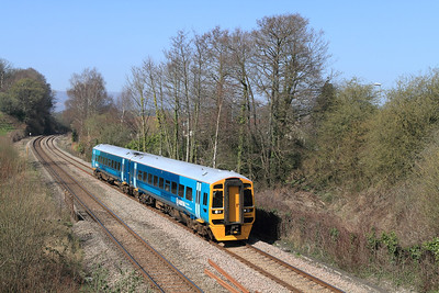 The 12.35 Hereford to Cardiff passes Ponthir formed of 158825 in the new Arriva Trains Wales livery. Tuesday 27th March 2012.