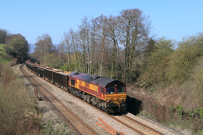 66008 passes Ponthir with 6Z35 12.48 Moreton-on-Lugg to Acton Yard loaded stone. Tuesday 27th March 2012.