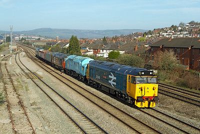 I picked the wrong location for this working as the light was to head on but didn't have enough time to move somewhere else. 6F50 09.08 Cardiff Canton to Kidderminster SVR with 50049 'Defiance' top & tailed with 50044 'Exeter' with 37308, 95194, 200176, 201056 & 50035 'Ark Royal' passing East Usk Yard. Thursday 29th March 2012.