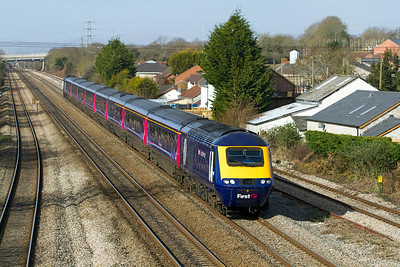 The 08.28 Swansea to Paddington passes Magor with power cars 43151 & 43179 in charge. 8th March 2012.