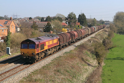 66165 passes Portskewett with 6V05 09.10 Round Oak to Margam empty steel carriers. Tuesday 27th March 2012.