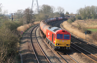 60007 'The Spirit of Tom Kendell' passes Duffryn westbound with 6B33 13.35 Theale to Robeston empty tanks. Tuesday 27th March 2012.