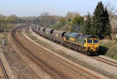 66531 passes Undy with 4F56 10.42 Uskmouth to Portbury empty coal hoppers. Thursday 29th March 2012.
