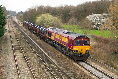 66046 passes Hatherley Loop with a very short 6M96 05.50 Margam to Corby loaded coil train. Friday 16th March 2012.