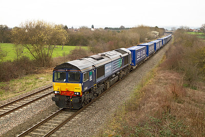 Ex Fastline 66302 heads the 4V38 08.22 Daventry to Wentloog Tesco Less CO2 train past Badgeworth, Friday 16th March 2012.