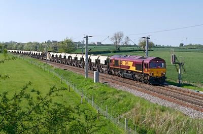 66092 heads 6B30 12.53 Mountsorrel to Northampton loaded Lafarge self discharge train past Watford Village. Tuesday 22nd May 2012.