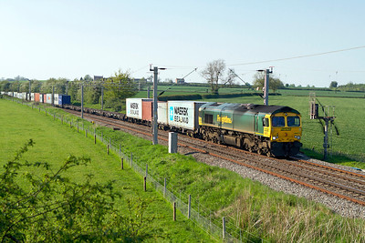 66571 heads 4L68 13.20 Birch Coppice to Felixstowe Freightliner past Watford Village. Tuesday 22nd May 2012.