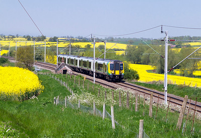 350255 heads through the rape fields at Church Brampton southbound for Euston. Tuesday 22nd May 2012.
