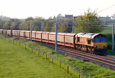 In the last of the evening light 66061 passes Watford Village on the Northampton Loop with 6O38 16.57 Halewood to Southampton East Docks loaded car carriers. Tuesday 22nd May 2012.