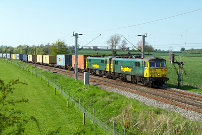 86613 & 86612 pass Watford Village on the Northampton Loop with 4L92 14.03 Ditton to Felixstowe Freightliner. Tuesday 22nd May 2012.