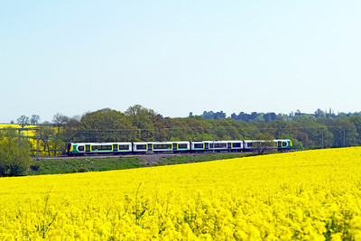 A Class 350 heads north through the rape fields at Church Brampton on the Northampton Loop. Tuesday 22nd May 2012.