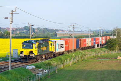 Running about an hour late 70020 passes Watford Village with 4M93 14.36 Felixstowe to Lawley Street Freightliner. Tuesday 22nd May 2012.