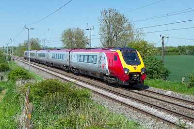221103 forming the 1B50 13.30 Birmingham New Street to Euston passes Long Buckby Road diverted onto the Northampton Loop due to a 11 car Pendolino having failed on the main line with brake problems. Tuesday 22nd May 2012.