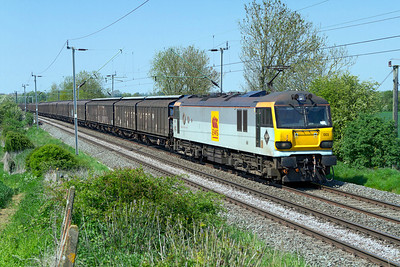 92003 'Beethoven' heads south past Long Buckby Road with 6A42 14.42 Daventry to Wembley Yard empty cargowagons. Tuesday 22nd May 2012.