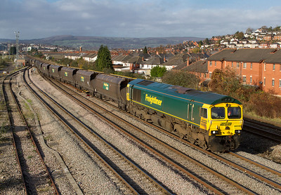 Having run-round it's train, 66598 heads out of East Usk Yard with 4F56 10.42 Uskmouth Power Station to Stoke Gifford Yard empty hoppers. 25th November 2011.