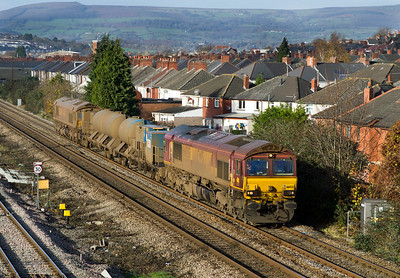 Not getting any cleaner, the Barton Hill based RHTT with loco's 66035 & 66079 'Benjamin Gimbert G.C.' as the 3S59 07.43 Moreton-on-Lugg to Weston-super-Mare pass East Usk Junction on the 'up' main. Friday 25th November 2011.