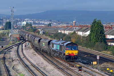 EX DRS 66415 now with Freightliner but still in full DRS livery having run-round it's train departs from East Usk Yard with 4F56 10.42 Uskmouth Power Station to Stoke Gifford Yard empty coal hoppers. Wednesday 23rd November 2011.
