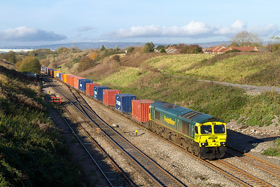 66590 climbs Pilning Bank past Pilning Village with 4O51 09.58 Wentloog to Southampton Freightliner, Thursday 17th November 2011.