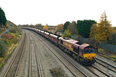 66230 passes East Usk Junction with 6B68 09.24 Avonmouth to Aberthaw Power Station loaded coal hoppers. 23/11/2011.