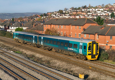 158834 in the new Arriva Trains Wales livery passes East Usk Junction forming the 09.17 Maesteg to Cheltenham Spa. 25/11/2011.
