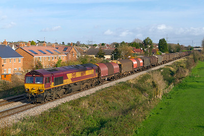 66095 passes Portskewett with 6V05 09.25 Round Oak to Margam empty steel carriers. Friday 25th November 2011.