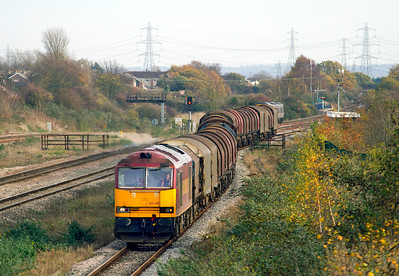 60049 is on the slow at Severn Tunnel Junction heading 6V05 09.25 Round Oak to Margam empty steel carriers. 23/11/2011