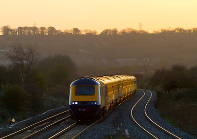The 06.45 Paddington to Swansea with power cars 43092 & 43145 catches the glint as it passes Pilning, 25th November 2011.