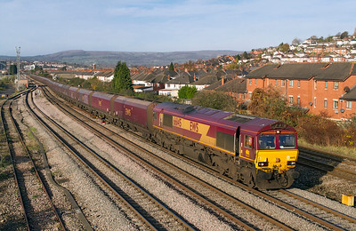 66145 heads 4E66 08.55 Margam to Redcar empty coke hoppers past East Usk Junction, Friday 25th November 2011.