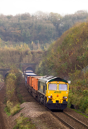 66533 has just emerged from the shorter of the two Patchway 'down' tunnels with 4V50 10.54 Southampton to Wentloog Freightliner. 10/11/2011.