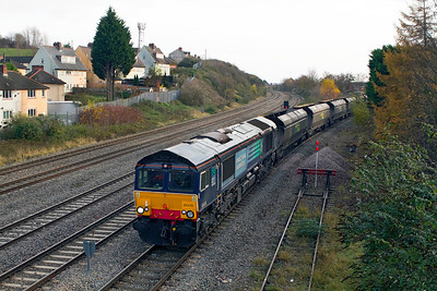 66415 comes off the Uskmouth Branch at East Usk Junction with 4F56 10.42 Uskmouth Power Station to Stoke Gifford Yard empty hoppers. 23/11/2011.