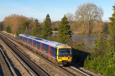 166205 forming the 1P45 13.01 Oxford to Paddington fast service passes Hinksey Yard. Thursday 29th November 2012.